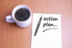Coffee helps ADHD, pen and notes write action plan.
