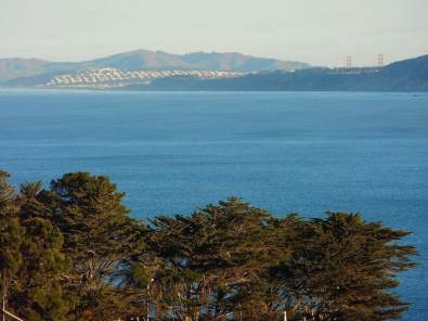 Photo taken from our expansive windows: Cobalt Blue Pacific Ocean + City of SF.