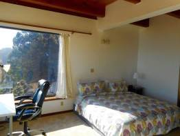Master Bedroom, Sunrise window, on left is all glass wall w/ ocean & S.F. views.