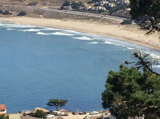 Picture taken from our decks and rooms. Surfers in the waves; fun beach walk.