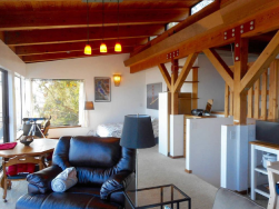 Penthouse: across the wide space and open beams and natural wood ceilings.