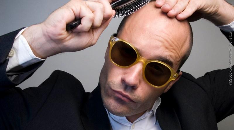 Bald man with hairbrush