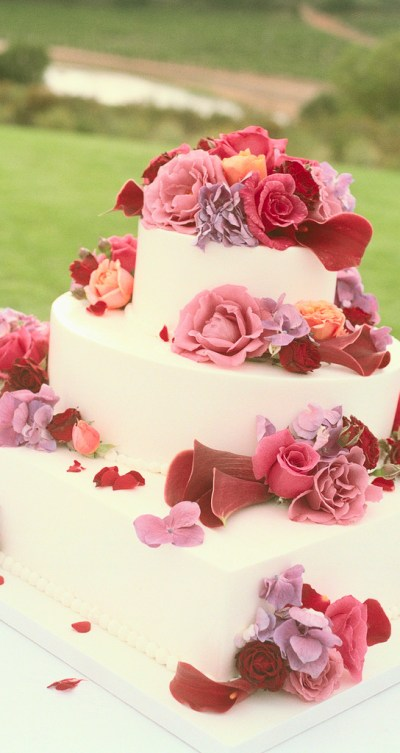 wedding cake designed with pink flowers