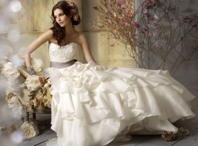 white sleeveless wedding dress with natural waistline