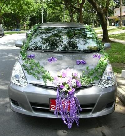 decorated wedding car with flowers and leaves