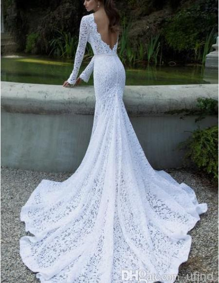 long fitted lace wedding dress with long train