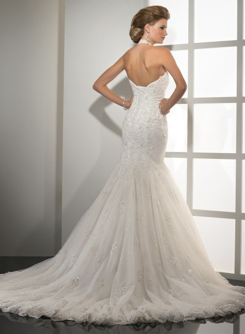 mermaid styled floor length wedding dress with open back
