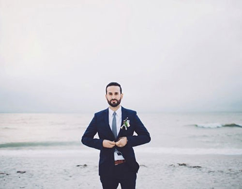 men beach wedding outfit with preppy style