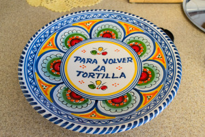 I have a dish especially made for flipping tortillas.  I just love it.