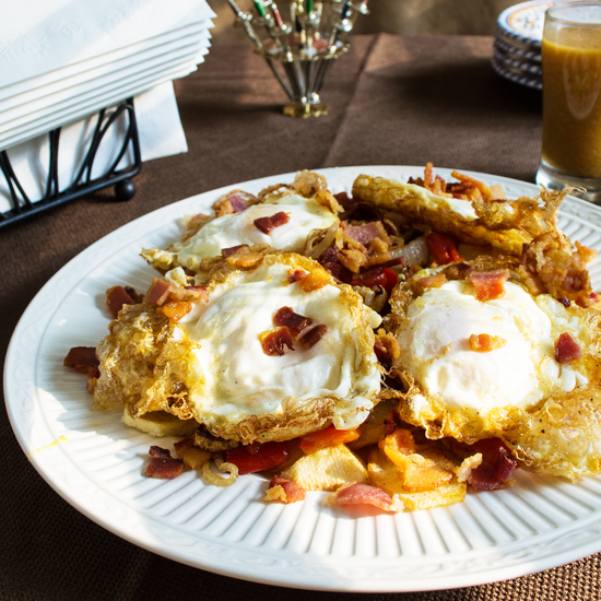 Huevos Rotos is a Spanish tapa of fried eggs over a bed of fried potatoes. Simply delicious.
