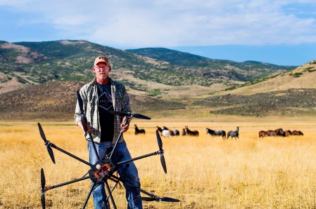 KYLER DAYBELL / MESSENGER PHOTO Scott Noll, owner and operator of Tate Farms in Fountain Green, is running his ranch with some progressive concepts, like using drones to monitor wild horses being housed under BLM contract.