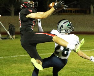 North Sanpete High School senior Kelton Christensen makes a leap for the ball in the game against the Timpanogos Timberwolves on Friday. The Hawks beat Timpanogos, 36-28, earning their first win of the season.