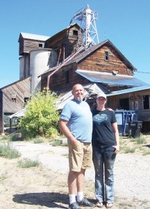 Erick and Jette Utley stand beside historic Fairview Roller Mills, which they are ambitiously preserving and converting into a home. - Lloyd Call / Messenger photo