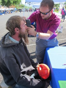 Jake Robison, optometrist at the Ephraim Eye Center, performs a test on Josh Carpenter, who was visiting from Draper, during Family Health and Safety Fair.