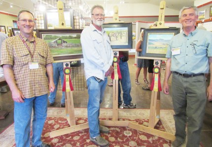 The top three winners of the annual Spring City Arts Plein Air Art Show stand by their paintings, which were displayed during a reception held at the Spring City Arts Gallery last Friday. (L-R): J. Ken Spencer, third place; Steven Heward, first place; and George Handrahn, second place.