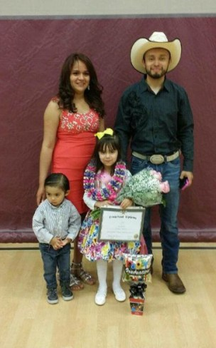 Azucena Jasmine (back left) and her husband Richard Tinoco (Back right) and their two children were one of the families whose home burned down after a fire started on their neighbor's property.