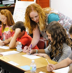 Allynne Mower, new Fairview Elementary principal, helps students with school work and says she believes a positive attitude in a well-rounded environment will help create happy, hardworking and productive members of society.