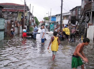 People of Guyana live in wet conditions year around and can get a dangerous 110 inches of rain annually in coastal regions, oftentimes leaving people to soak inside their homes.