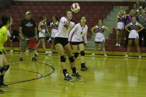 Marquel Justice (No. 25) fields a serve in the Templar's loss to North Sevier as Ana Cruz (No. 4) watches.