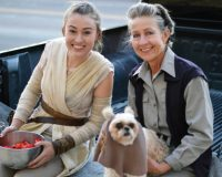 """Kate and Susan Murdoch (holding dog) are both garbed in spot-on Star Wars regalia and accompanied by their Ewok """"Missy"""" during Manti's Trunk or Treat event on Monday - Robert Stevens / Messenger photo"""