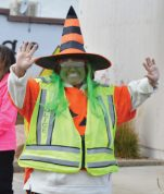 This crossing guard smiles from behind a painted face during the Mt. Pleasant Halloween parade.