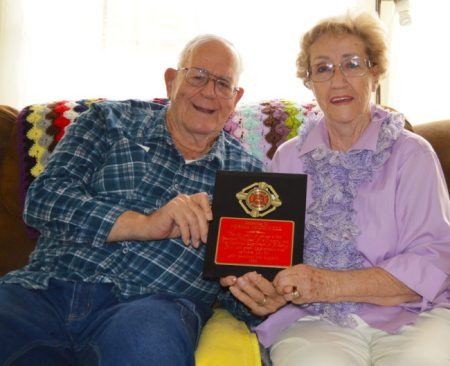 Norma McDonnell, with husband Fred, holds a plaque that was awarded to her by the California Department of Forestry for 20 years of dedicated service.