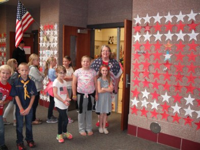 Wendy Christofferson's third-grade class helped line the school hallways with stars to honor a veteran they know.