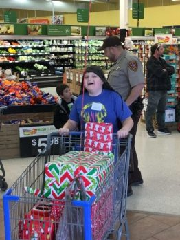 Sanpete County Deputy Kyle Adams went shopping with Riley, pictured here, as part of the Shop with a Cop event last Saturday. - Matt Harris / Messenger photo