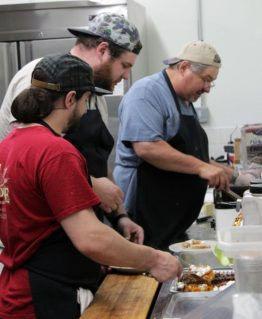 Dirk Correnti (back right) worked alongside family, employees and volunteers to provide a Thanksgiving dinner to anyone who wants one—for free—for the fifth year running. - Photo courtesy Gene Chantry