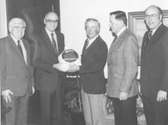 Leaders in the Utah turkey industry present a turkey to Utah Gov. Scott Matheson in the early 1980s. From left are John McDade, president of Norbest; the governor; Dick Olson of Ephraim, chairman of the Utah Turkey Marketing Board; O'Neil Larsen, chairman of the board of Moroni Feed Co.; and John Hall of Manti, chairman of the Norbest board of directors.