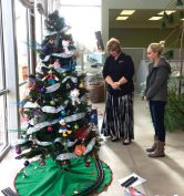 Pam Rigby (left) and Miss Sanpete Katie Nielsen admire one of the fully-decorated, donated trees that are being exhibited at the Fairview Museum. On Dec. 17, the donated trees will be given to families in need. - Terry Madsen / Messenger photo