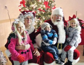 Mr. and Mrs. Claus were present during Gunnison's Christmas celebrations on Saturday. Children lined up to claim their spot on his lap and whisper wishes in his ears. - Tom Osmond / Messenger photo