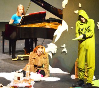 """Manti High School student Carson Lawrence brought the Grinch to life, along with his trusty K-9 companion Max, played by Brynn Peterson, in the drama department's adaptation of a radio-style rendition of the """"How the Grinch Stole Christmas."""""""