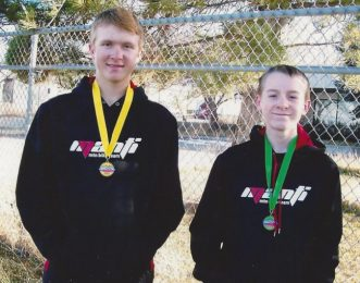 Riley Oberg (left) and Tyson Meade display medals earned at the Utah High School Mountain Bike League middle school finals on the former Olympic cross-country course at Soldier Hollow in Midway.