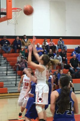 Junior Kysha Barbel went hard to the hoop on this drive against the Gunnison Bulldogs defense in the second quarter last Tuesday. The game was every bit in the Lady Tigers' favor in a 93-40 domination. - Matt Harris / Messenger photo