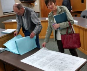 Council members Kevin Stallings and Heidi Kelso inspect the preliminary plans for the new swimming pool at the Mt Pleasant City Council meeting. - James Tilson / Messenger photo
