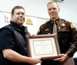 Former UHP Section 10 supervisor Lt. Thayne Carlisle, left accepts an award from UHP Major Jess Anderson on Friday Jan. 27, upon his retirement from UHP. Carlisle, who has also served on Gunnison City Council, has taken a position in security at Temple Square in Salt Lake City.