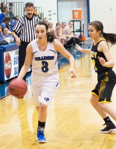Paige King, desperately trying to create a play here against top-ranked Emery, had nine points against the Lady Spartans, a bright spot amidst a 73-36 shellacking. - Matt Harris / Messenger photo