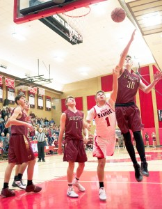 Sophomore Shawn Taylor draws contact under the basket against Juab. Taylor was one of four players in double figures on the night, scoring 14 points. - Matt Harris / Messenger photo