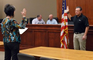 Gunnison City Recorder Janel Braithwaite (left) swears in new council member Shawn Crane (right) to fill the council seat left empty by Thayne Carlisle, who recently resigned. - Robert Stevens / Messenger photo