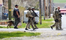 Utah County tactical police units, who had been called in by Fairview City Police Chief Bob Bingham, support local law enforcement during the standoff with Lamb.