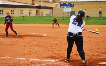 Senior Ashley Roberts cracks off a homerun in the Lady Bulldogs' first win of a doubleheader sweep against the Lady Wolves on Tuesday, April 11.