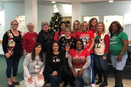 staff in ugly Christmas sweaters