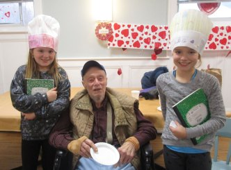 Read a Recipe for Literacy with resident