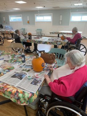 Residents decorating pumpkins