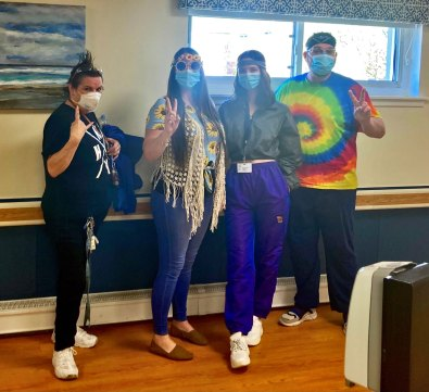 group of San Simeon staff dressed up for Decade Day