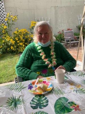 female San Simeon resident enjoying a luau