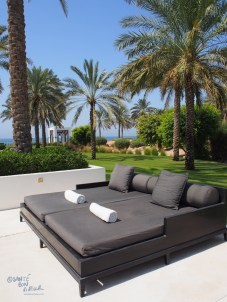 Loungers by the 103m long pool