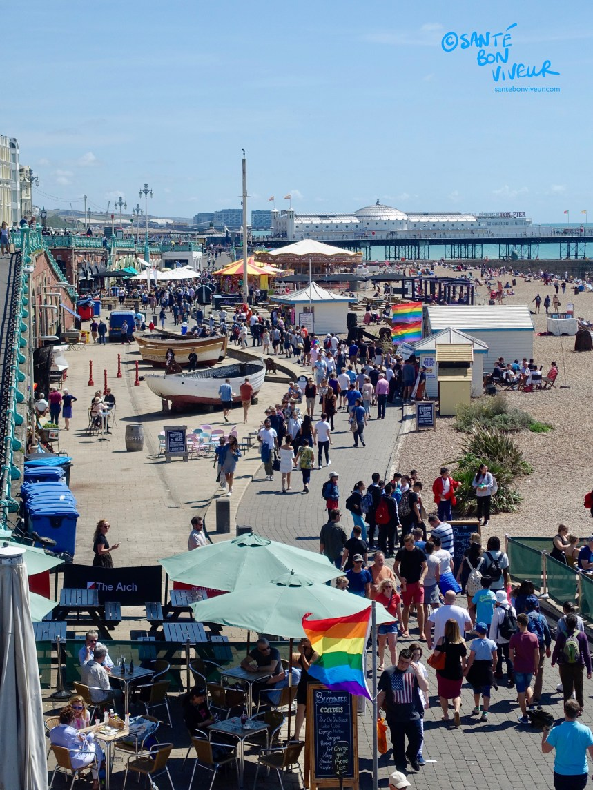 Bustling Brighton seafront lower promenade & the King's Road Arches, looking towards the Palace Pier