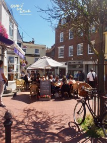 The Lanes' narrow, winding streets open up into squares like this, perfect for eating outside on a summer's day